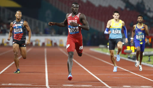 Qatar's Abdalelah Hassan, second left, leads the field to the finish line to win the men's 400m final during the athletics competition at the 18th Asian Games in Jakarta, Indonesia, Sunday, Aug. 26, 2018. (AP Photo/Bernat Armangue)
