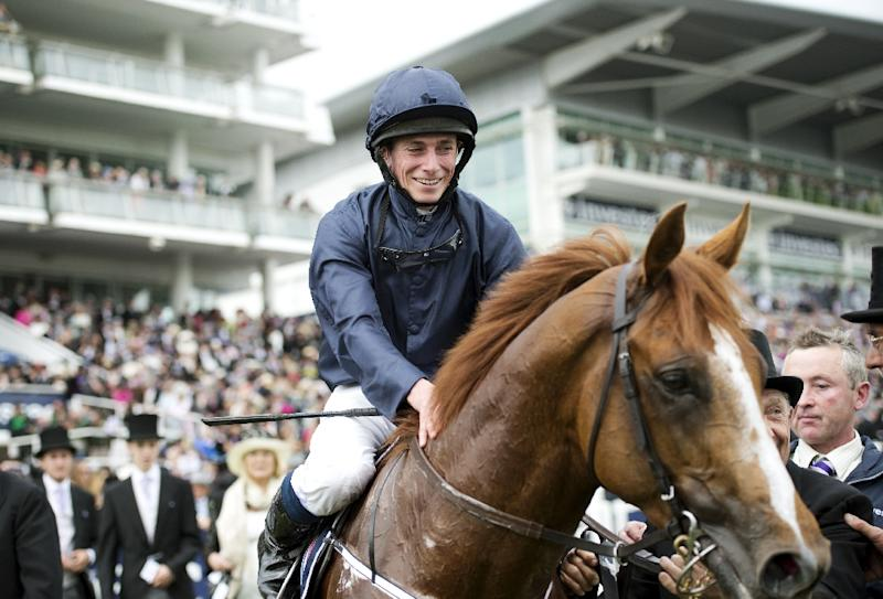 Ruler of the World ridden by Ryan Moore is one of six Epsom Derby winners for Irish trainer Aidan O'Brien who has seven of the 13 runners on Saturday as he bids for a record-equalling seventh victory with Moore riding Sir Dragonnet (AFP Photo/ADRIAN DENNIS)