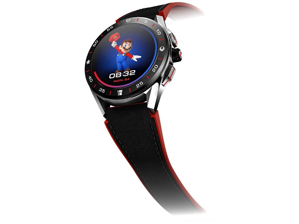 <p>Off angle view of the Tag Heuer Connected Limited Edition Super Mario with a black-and-red strap. The watch face features Mario holding his cap up.</p>
