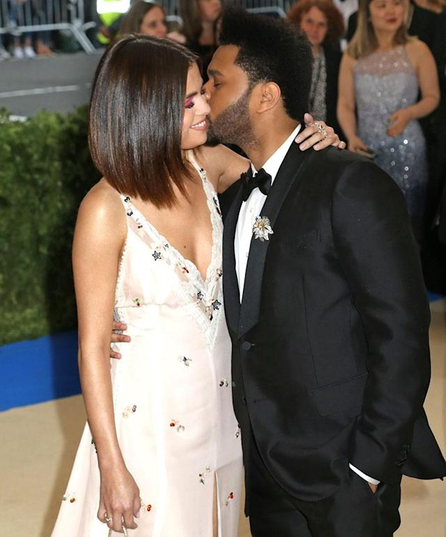 "<p>The couple reportedly was already dropping ""L bombs"" five months into their relationship. According to a report from the Met Gala, Selena whispered, ""<a href=""https://www.yahoo.com/celebrity/selena-gomez-weeknd-make-cuddly-red-carpet-debut-met-gala-004414241.html"" data-ylk=""slk:I love you"" class=""link rapid-noclick-resp"">I love you</a>,"" into her beau's ear on the red carpet. (Photo: NYDN/BACKGRID) </p>"