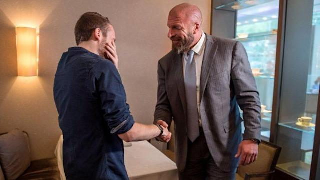 London police officer Charlie Guenigault meets Triple H. (Photo courtesy of WWE)