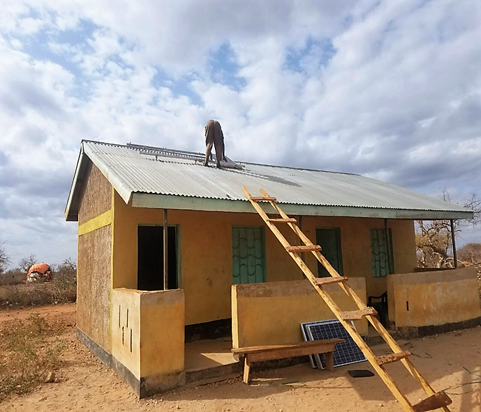 A Solar Direct Drive (SDD) Refrigerator being installed in a rural Kenyan health facility (Dr Lucy Mecca)