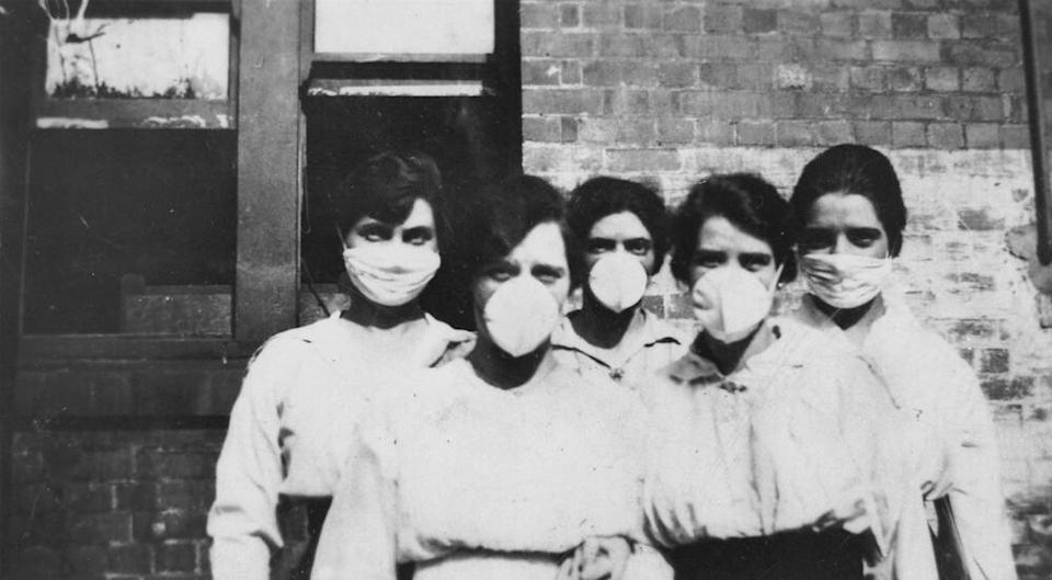 Brisbane (Australia) women wearing surgical masks during the 1918 flu epidemic. (Creative commons image seen on Flickr - credit: Queensland State Library).