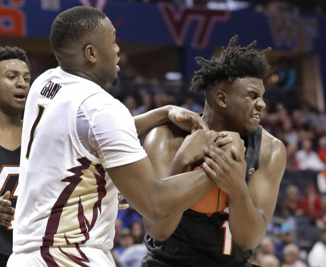 Virginia Tech's Isaiah Wilkins, right, and Florida State's Raiquan Gray, left, fight for a rebound during the first half of an NCAA college basketball game in the Atlantic Coast Conference tournament in Charlotte, N.C., Thursday, March 14, 2019. (AP Photo/Nell Redmond)