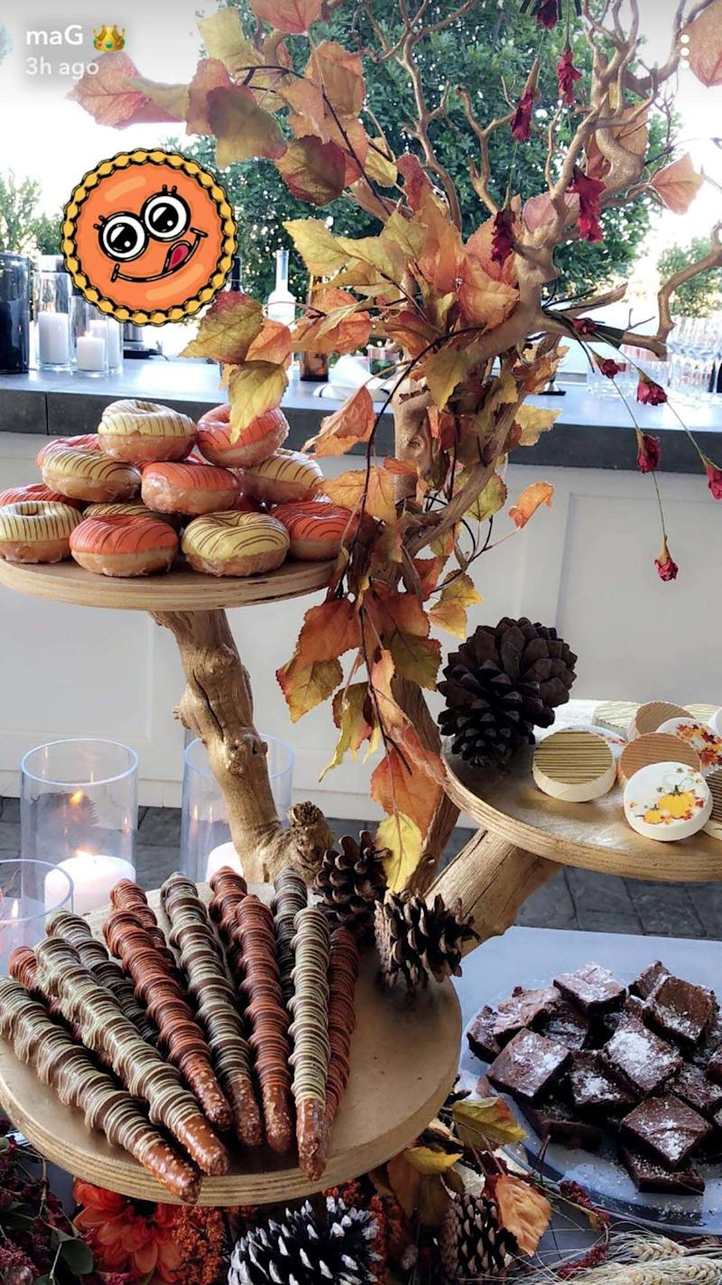For dessert, Kylie served autumnal doughnuts and turkey-shaped Rice Krispie treats, among other goodies.