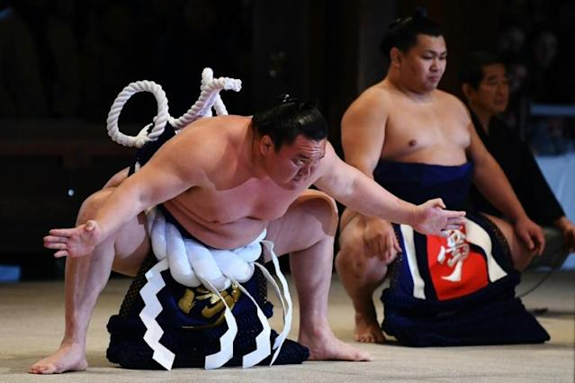 A handful of lower-ranking sumo wrestlers, trainees and a stable master have contracted coronavirus in Japan (AFP Photo/CHARLY TRIBALLEAU)