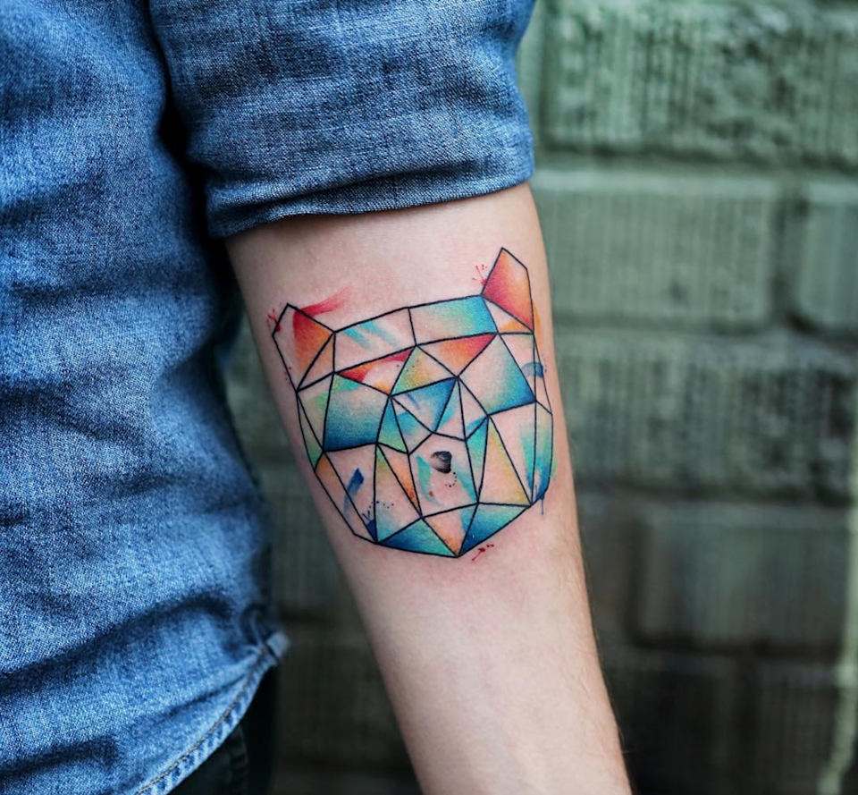 With colored accents so bright that they're almost neon, a graphic bear tattoo goes from minimalist to major.