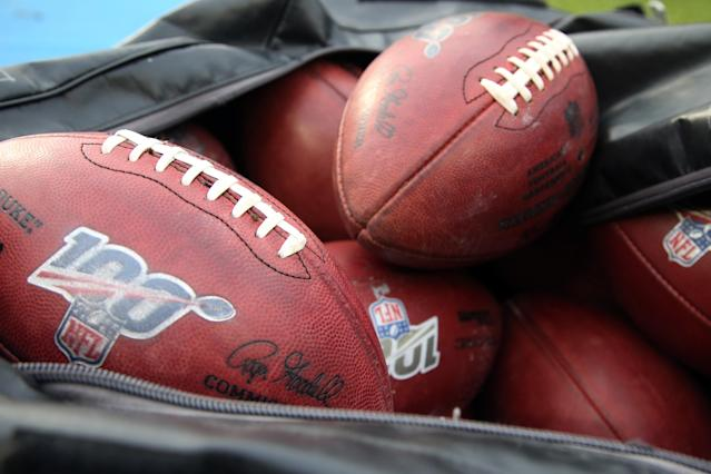"""LOS ANGELES, CA - DECEMBER 22: Official Footballs with NFL 100th Anniversary logo during an NFL game between the <a class=""""link rapid-noclick-resp"""" href=""""/nfl/teams/oakland/"""" data-ylk=""""slk:Oakland Raiders"""">Oakland Raiders</a> and the Los Angeles Chargers on December 22, 2019, at Dignity Health Sports Park in Los Angeles, CA. (Photo by Kiyoshi Mio/Icon Sportswire via Getty Images)"""