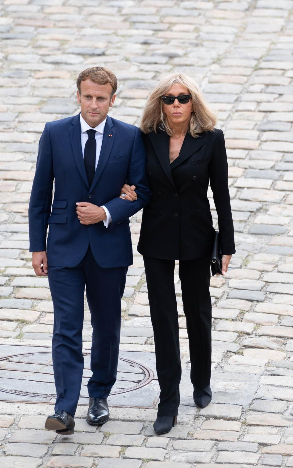 French President Emmanuel Macron (left) and his wife Brigitte Macron arrive to attend the national tribute ceremony to the late French actor Jean-Paul Belmondo at the Hôtel des Invalides monument.  - Credit: Jacques WITT / SIPA