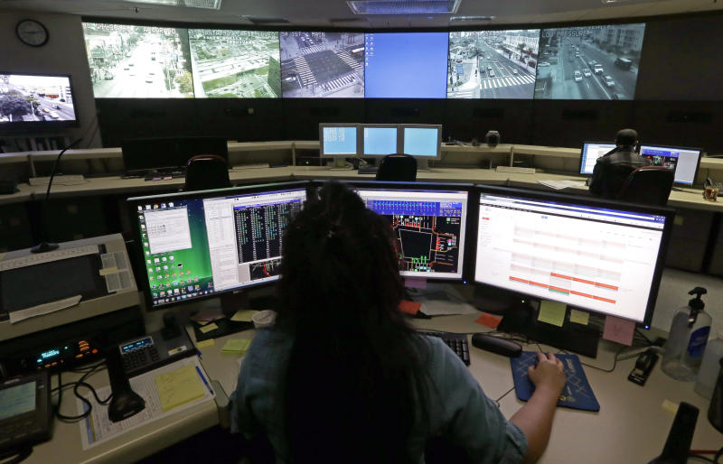This Wednesday, April 24,2013 photo shows transportation engineer associate Abeer Kliefe working at the Los Angeles Department of Transportation's Automated Traffic Surveillance and Control Center in downtown Los Angeles. In small towns and big cities, police and politicians are pointing to the surveillance video that was key to identifying the Boston Marathon bombing suspects as a reason to bolster their own networks and get more electronic eyes on their streets. In Los Angeles, a councilman wants police to broaden their network by giving them access to traffic cameras used to monitor the flow of cars on the road. (AP Photo/Reed Saxon)