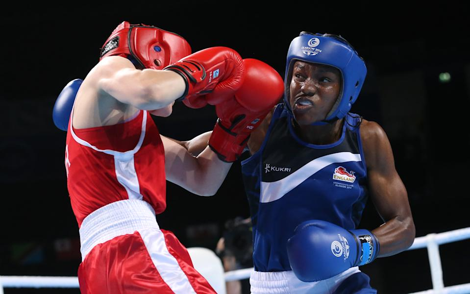 Nicola Adams, right, of England  trades punches with Michaela Walsh of Northern Ireland during the gold medal women's flyweight boxing bout at the Commonwealth Games Glasgow 2014, in Glasgow, Scotland, Saturday, Aug. 2, 2014. Adams won the gold medal.(AP Photo/Peter Morrison)