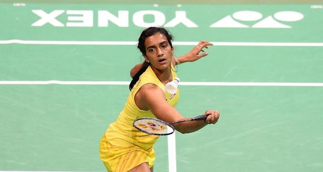 India's PV Sindhu plays against Spain's Carolina Marin during the women's singles final at the India Open badminton tournament in New Delhi on April 2, 2017 (AFP Photo/SAJJAD HUSSAIN)