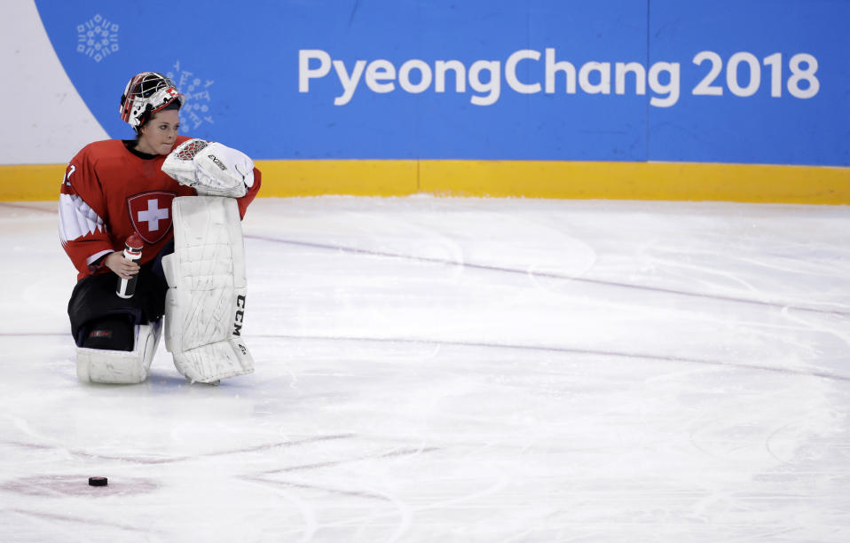 goalie Florence Schelling (41), of Switzerland, kneels as she takes a water break during the third period of the preliminary round of the women's hockey game against Japan at the 2018 Winter Olympics in Gangneung, South Korea, Monday, Feb. 12, 2018. (AP Photo/Julio Cortez)