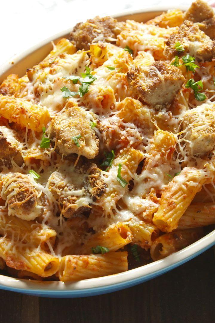 """<p><a href=""""https://www.delish.com/uk/cooking/recipes/a29029898/easy-chicken-parmesan-recipe/"""" rel=""""nofollow noopener"""" target=""""_blank"""" data-ylk=""""slk:Chicken Parm"""" class=""""link rapid-noclick-resp"""">Chicken Parm</a> AND <a href=""""https://www.delish.com/uk/pasta-recipes/"""" rel=""""nofollow noopener"""" target=""""_blank"""" data-ylk=""""slk:pasta"""" class=""""link rapid-noclick-resp"""">pasta</a>, what more could you want? </p><p>Get the <a href=""""https://www.delish.com/uk/cooking/recipes/a31467605/chicken-parm-rigatoni-bake-recipe/"""" rel=""""nofollow noopener"""" target=""""_blank"""" data-ylk=""""slk:Chicken Parm Rigatoni Bake"""" class=""""link rapid-noclick-resp"""">Chicken Parm Rigatoni Bake</a> recipe.</p>"""