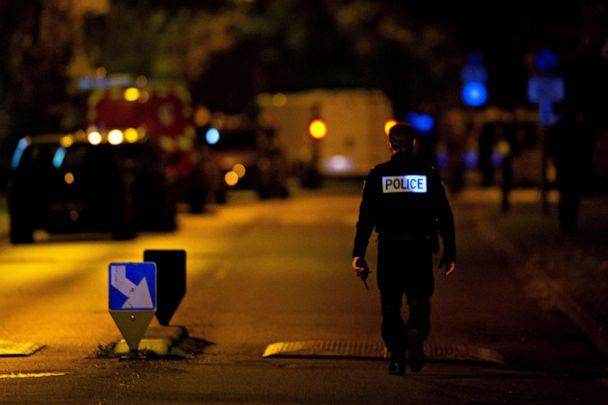 PHOTO: A police officer stands guard on a street on Oct. 16, 2020, where an attacker was shot dead by police after he decapitated a man in Conflans-Sainte-Honorine, France. (Abdulmonam Eassa/AFP via Getty Images)
