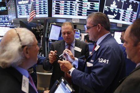 Traders work on the floor of the NYSE
