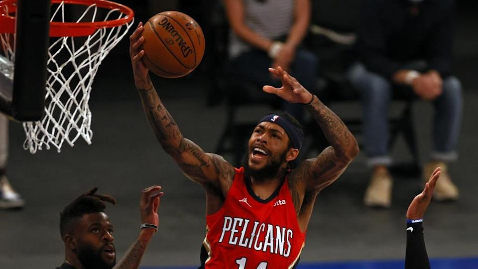 Apr 18, 2021; New York, New York, USA; New Orleans Pelicans forward Brandon Ingram (14) drives to the basket past New York Knicks forward Reggie Bullock during the first half at Madison Square Garden. Mandatory Credit: Adam Hunger/POOL PHOTOS-USA TODAY Sports