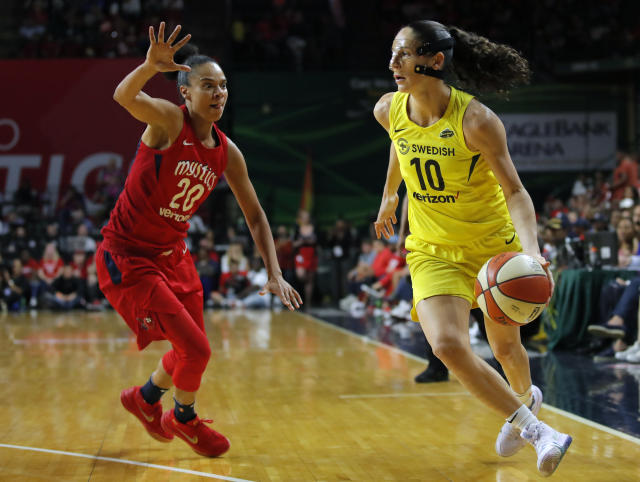 "<a class=""link rapid-noclick-resp"" href=""/wnba/teams/sea"" data-ylk=""slk:Seattle Storm"">Seattle Storm</a> guard <a class=""link rapid-noclick-resp"" href=""/wnba/players/500/"" data-ylk=""slk:Sue Bird"">Sue Bird</a> (10) drives around <a class=""link rapid-noclick-resp"" href=""/wnba/teams/was"" data-ylk=""slk:Washington Mystics"">Washington Mystics</a> guard <a class=""link rapid-noclick-resp"" href=""/wnba/players/4563/"" data-ylk=""slk:Kristi Toliver"">Kristi Toliver</a> (20) during the second half of Game 3 of the WNBA basketball finals, Wednesday, Sept. 18 2018, in Fairfax, Va. The Seattle Storm won 98-82. (AP Photo/Carolyn Kaster)"
