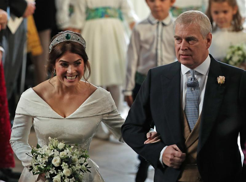 Princess Eugenie of York pictured walking down the aisle with her father Prince Andrew on her wedding day