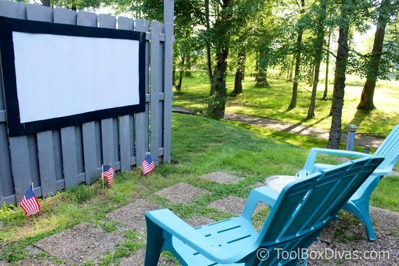 """<p>If you're limited on time and want to get movie night rolling as soon as possible, this idea from Toolbox Divas can be set up in under an hour. It involves <a href=""""https://toolboxdivas.com/dollar-tree-outdoor-movie-theater-and-projection-screen/"""" rel=""""nofollow noopener"""" target=""""_blank"""" data-ylk=""""slk:mounting a shower curtain with tape"""" class=""""link rapid-noclick-resp"""">mounting a shower curtain with tape</a> to a tall surface such as a fence or side of a house.</p><p><strong>See more at <a href=""""https://toolboxdivas.com/dollar-tree-outdoor-movie-theater-and-projection-screen/"""" rel=""""nofollow noopener"""" target=""""_blank"""" data-ylk=""""slk:Toolbox Divas"""" class=""""link rapid-noclick-resp"""">Toolbox Divas</a>.</strong></p>"""