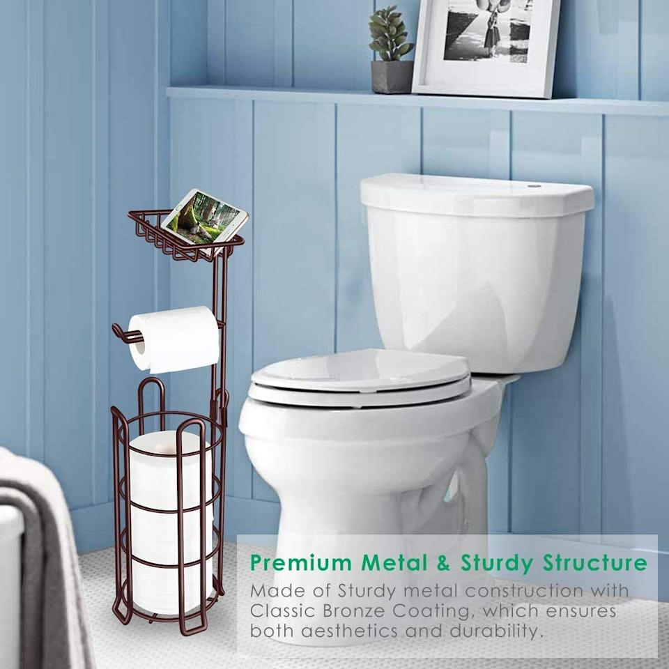"""This one can store up to three rolls at a time and even has a lil' shelf to rest your phone while you do your business. Genius.<br /><br /><strong>Promising review:</strong>""""<strong>This toilet paper holder and stand is perfect for dispensing the TP, storing extra rolls, and is a very sturdy accessory. It requires no tools to put it together.</strong>The shelf on top can be used to hold other, lightweight items such as wipes, or a cellphone if you absolutely have to have it with you.<strong>I would definitely recommend this product.</strong>"""" —<a href=""""https://www.amazon.com/dp/B07H9SSWPR?tag=huffpost-bfsyndication-20&ascsubtag=5834502%2C34%2C46%2Cd%2C0%2C0%2C0%2C962%3A1%3B901%3A2%3B900%3A2%3B974%3A3%3B975%3A2%3B982%3A2%2C16271141%2C0"""" target=""""_blank"""" rel=""""noopener noreferrer"""">lpufford</a><br /><br /><strong>Get it from Amazon for<a href=""""https://www.amazon.com/dp/B07H9SSWPR?tag=huffpost-bfsyndication-20&ascsubtag=5834502%2C34%2C46%2Cd%2C0%2C0%2C0%2C962%3A1%3B901%3A2%3B900%3A2%3B974%3A3%3B975%3A2%3B982%3A2%2C16271141%2C0"""" target=""""_blank"""" rel=""""noopener noreferrer"""">$19.54+</a>(available in three colors).</strong>"""