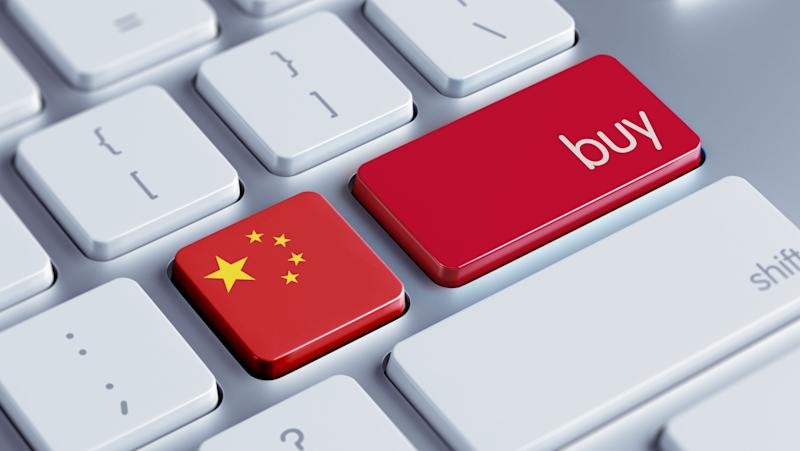 """Two buttons on a keyboard, one with a Chinese flag and another labeled as a """"buy"""" button."""
