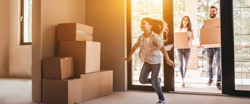 young family moving day into new house