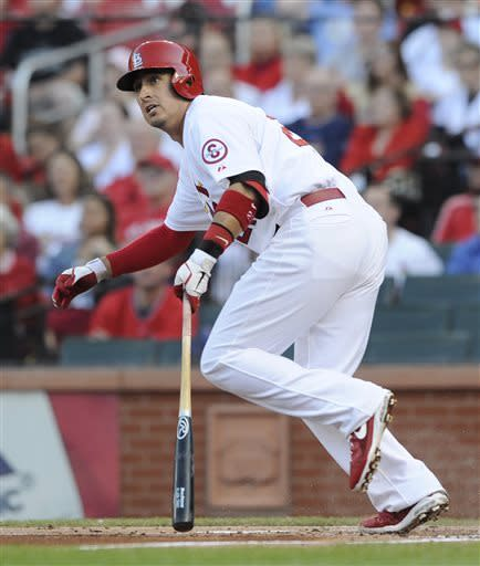St. Louis Cardinals' Allen Craig watches his RBI double against the New York Mets in the first inning in a baseball game Monday, May 13, 2013, at Busch Stadium in St. Louis. (AP Photo/Bill Boyce)