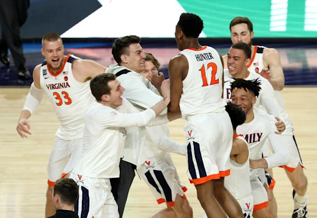 The Virginia Cavaliers celebrate after defeating the Texas Tech Red Raiders in the 2019 NCAA men's Final Four National Championship game at U.S. Bank Stadium on April 08, 2019 in Minneapolis, Minnesota. (Photo by Matt Marriott/NCAA Photos via Getty Images)