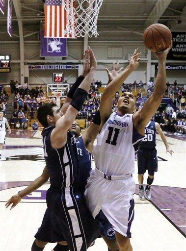 Northwestern guard Reggie Hearn (11) shoots and scores past Penn State's Nick Colella and Brandon Taylor during the first half of an NCAA college basketball game, Thursday, March 7, 2013, in Evanston, Ill. (AP Photo/Charles Rex Arbogast)