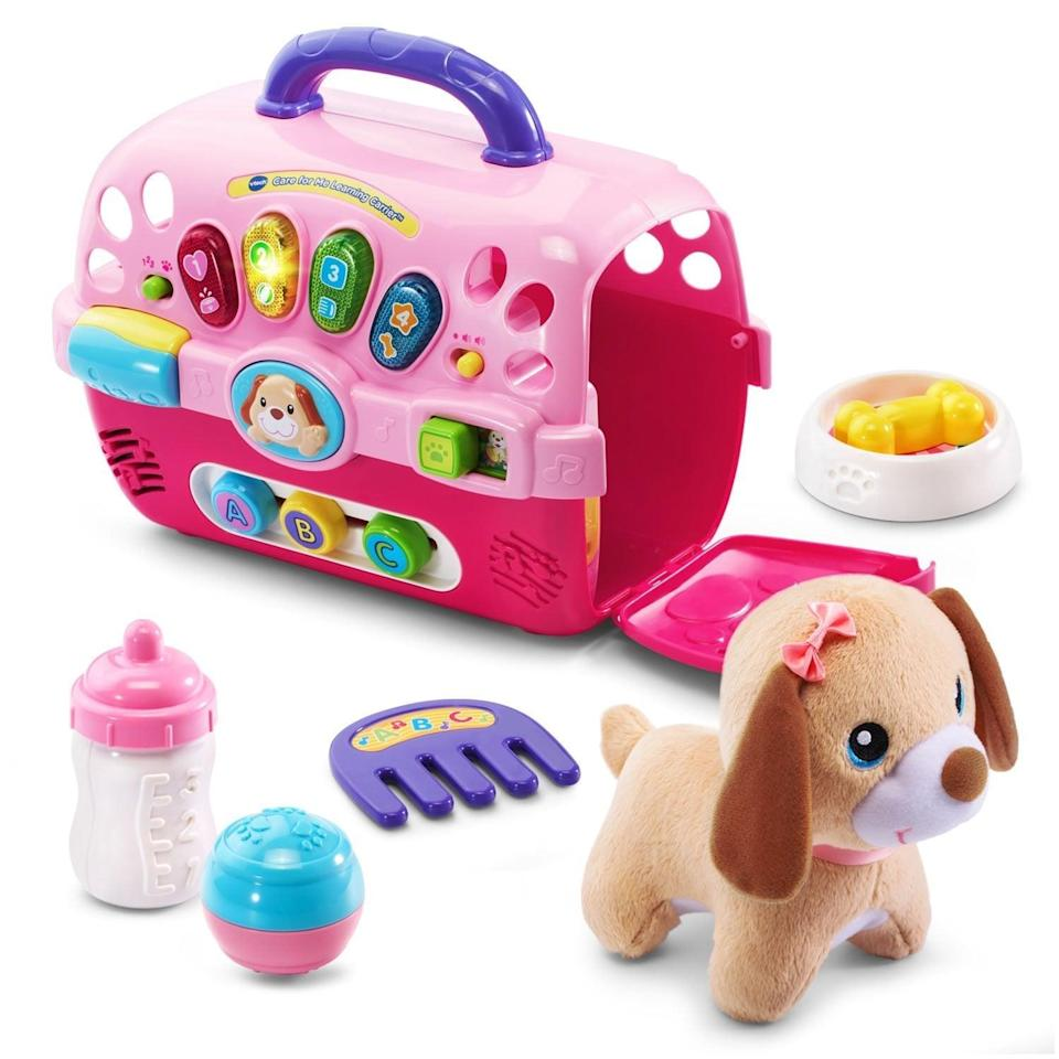 "<p>Show little ones how to look after pets with this <a href=""https://www.popsugar.com/buy/VTech-Care-Me-Learning-Carrier-Toy-423246?p_name=VTech%20Care%20for%20Me%20Learning%20Carrier%20Toy&retailer=walmart.com&pid=423246&price=25&evar1=moms%3Aus&evar9=25800161&evar98=https%3A%2F%2Fwww.popsugar.com%2Fphoto-gallery%2F25800161%2Fimage%2F44870053%2FVTech-Care-Me-Learning-Carrier-Toy&list1=gifts%2Camazon%2Choliday%2Ctoys%2Cchristmas%2Cgift%20guide%2Cparenting%2Ctoddlers%2Cgifts%20for%20kids%2Ckid%20shopping%2Choliday%20for%20kids%2Cgifts%20under%20%2450%2Cgifts%20under%20%2475%2Cgifts%20for%20toddlers%2Cbest%20of%202019&prop13=api&pdata=1"" class=""link rapid-noclick-resp"" rel=""nofollow noopener"" target=""_blank"" data-ylk=""slk:VTech Care for Me Learning Carrier Toy"">VTech Care for Me Learning Carrier Toy</a> ($25).</p>"