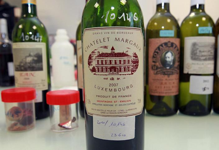 In this photo dated Tuesday, Nov. 12, 2013, example of a counterfeit bottle of wine is displayed in a lab run by the French Finance ministry in Bordeaux, southwestern France. Counterfeiting has dogged wine as long as it has been produced, but it is getting more sophisticated and more ambitious, particularly as bottle prices rise due to huge demand in new markets, mainly in Asia. (AP Photo/Bob Edme)