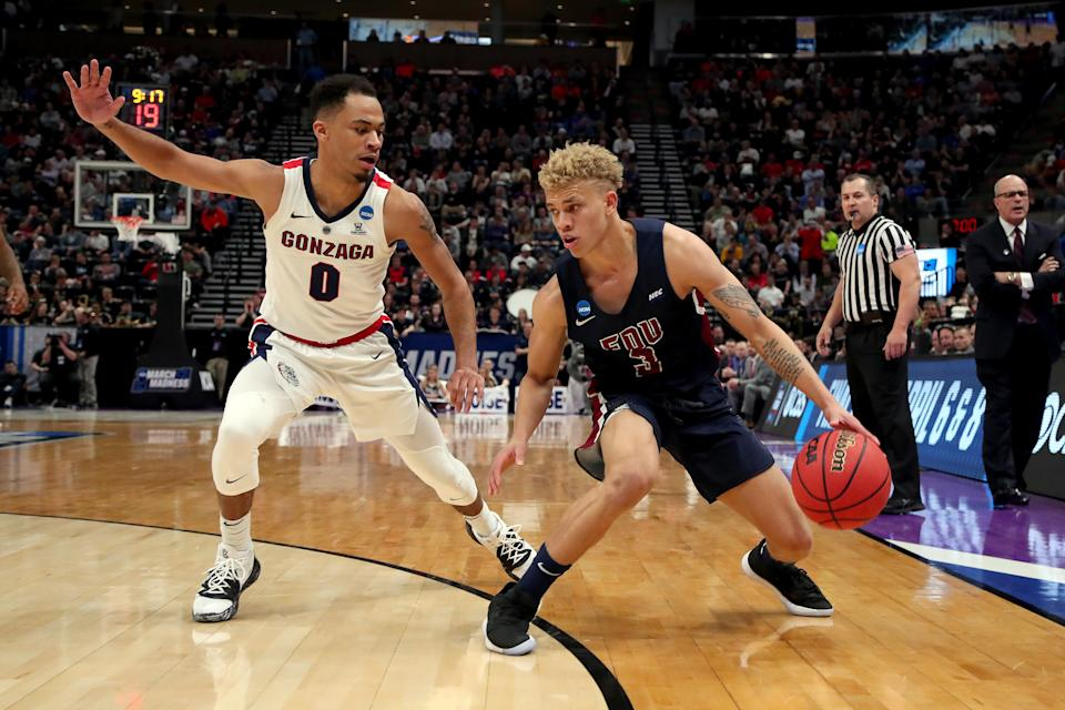 <p>Jahlil Jenkins #3 of the Fairleigh Dickinson Knights drives against Geno Crandall #0 of the Gonzaga Bulldogs during the second half in the first round of the 2019 NCAA Men's Basketball Tournament at Vivint Smart Home Arena on March 21, 2019 in Salt Lake City, Utah. </p>