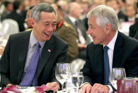 U.S. Secretary of Defense Chuck Hagel, right, and Singapore's Prime Minister Lee Hsien Loong attend the opening session of the International Institute for Strategic Studies Shangri-la Dialogue, or IISS Asia Security Summit on Friday, May 31, 2013 in Singapore. The meetings will be held from May 31 to June 2. (AP Photo/Wong Maye-E)