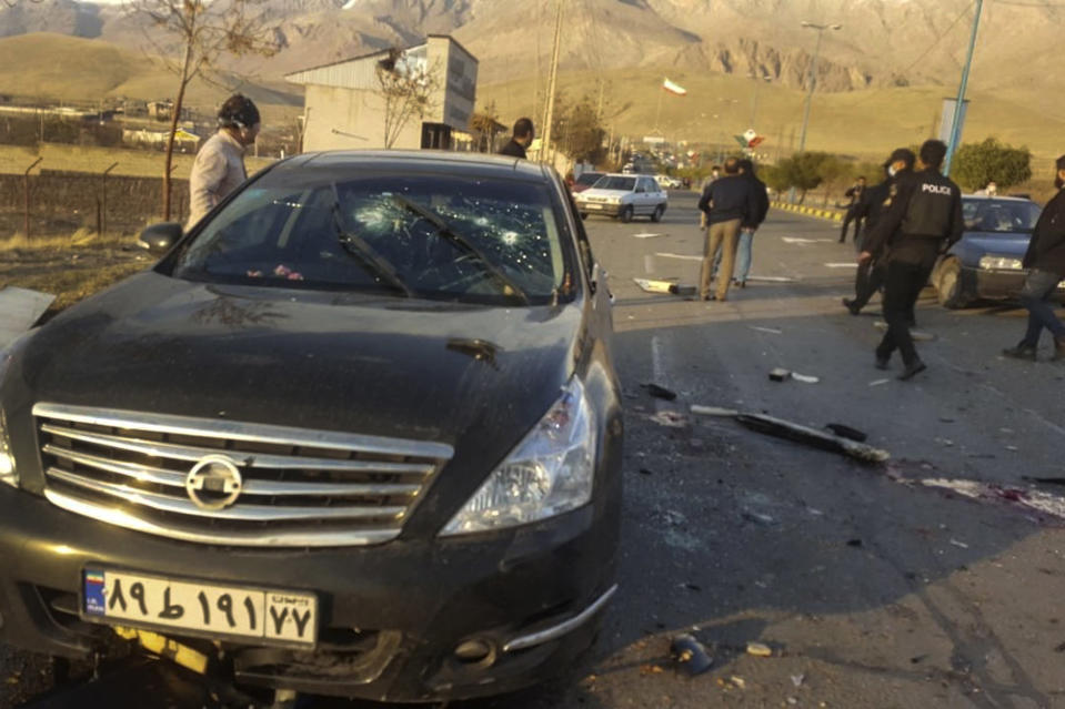 """This photo released by the semi-official Fars News Agency shows the scene where Mohsen Fakhrizadeh was killed in Absard, a small city just east of the capital, Tehran, Iran, Friday, Nov. 27, 2020. Fakhrizadeh, an Iranian scientist that Israel alleged led the Islamic Republic's military nuclear program until its disbanding in the early 2000s was """"assassinated"""" Friday, state television said. (Fars News Agency via AP)"""