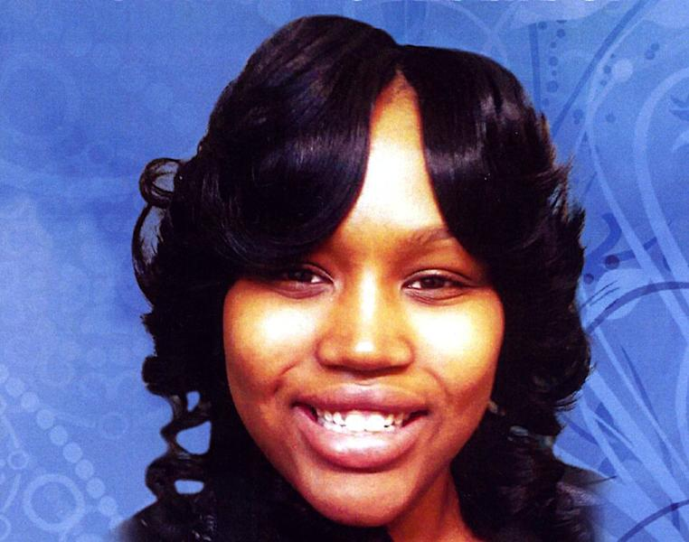 In this undated file photo is the cover of a funeral program showing 19-year-old Renisha McBride from a service in Detroit. Prosecutors plan to announce Friday, Nov. 15, 2013 whether they'll charge a suburban Detroit homeowner in the Nov. 2 shooting death of McBride. Autopsy results released after the shooting ruled McBride died of a gunshot wound to her face. (AP Photo/Detroit News) DETROIT FREE PRESS OUT; HUFFINGTON POST OUT