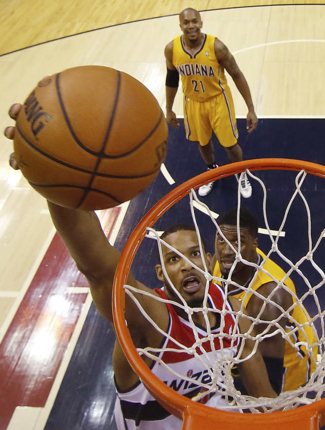 Washington Wizards forward Trevor Ariza (1) shoots past Indiana Pacers center Roy Hibbert (55) during the first half of Game 3 of an Eastern Conference semifinal NBA basketball playoff game in Washington, Friday, May 9, 2014. (AP Photo/Alex Brandon)