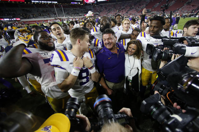 LSU head coach Ed Orgeron smiles at quarterback Joe Burrow after defeating Alabama 46-41. (AP Photo/John Bazemore)