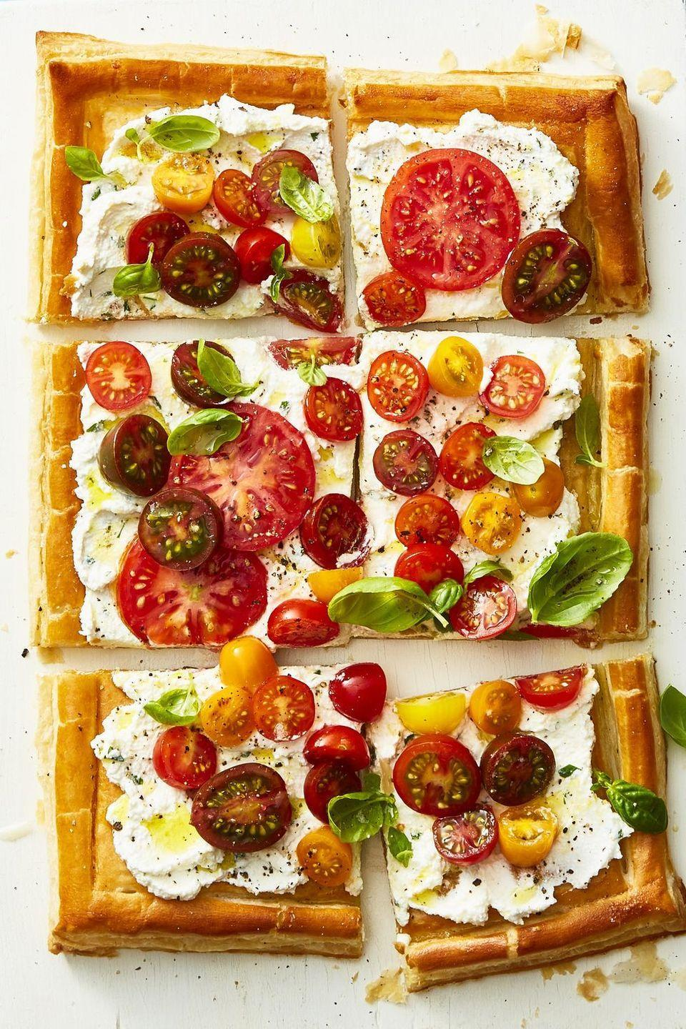 "<p>With all of the flavors of pizza, this fresh and elegant dinner is a real crowdpleaser. </p><p><em><a href=""https://www.goodhousekeeping.com/food-recipes/healthy/a22750354/herbed-ricotta-and-fresh-tomato-tart-recipe/"" rel=""nofollow noopener"" target=""_blank"" data-ylk=""slk:Get the recipe for Herbed Ricotta and Fresh Tomato Tart »"" class=""link rapid-noclick-resp"">Get the recipe for Herbed Ricotta and Fresh Tomato Tart »</a></em></p>"