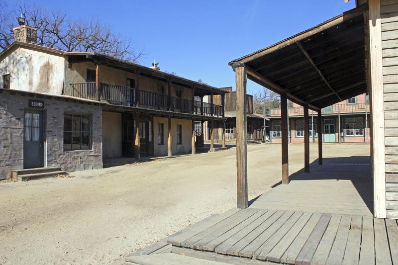 This Dec. 13, 2015 photo shows Paramount Ranch, a frontier western town built as a movie set that appeared in countless movies and TV shows, in Agoura Hills in Southern California. It was destroyed in the Woolsey fire. Southern Californians faced with the loss of lives and homes in a huge wildfire are also grappling with the destruction of public lands popular with hikers, horseback riders and mountain bikers. The Woolsey fire has charred more than 85 percent of National Park Service land within the Santa Monica Mountain National Recreational Area, where officials announced Wednesday, Nov. 14, 2018 that all trails were closed. (AP Photo/John Antczak)