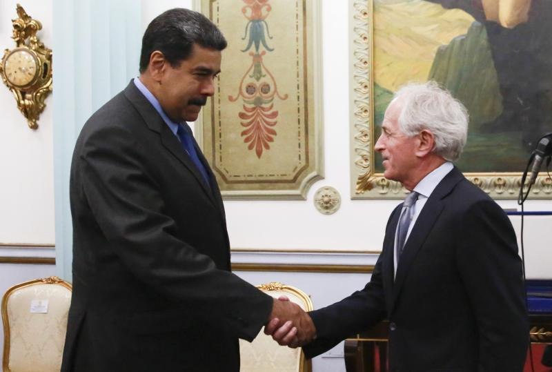 In this photo released by the Miraflores Presidential Press Office, Venezuela's President Nicolas Maduro, left, shakes hands with Republican Senator Bob Corker during a meeting at the Miraflores Presidential Palace in Caracas, Venezuela, Friday May 25, 2018. The Chairman of Senate Foreign Relations Committee met with Venezuelan President Nicolas Maduro two days after the embattled socialist leader kicked out the top U.S. diplomat in the country. There was no immediate comment from Republican Senator Bob Corker's office about the nature of the surprise visit. (Miraflores Presidential Press Office via AP)