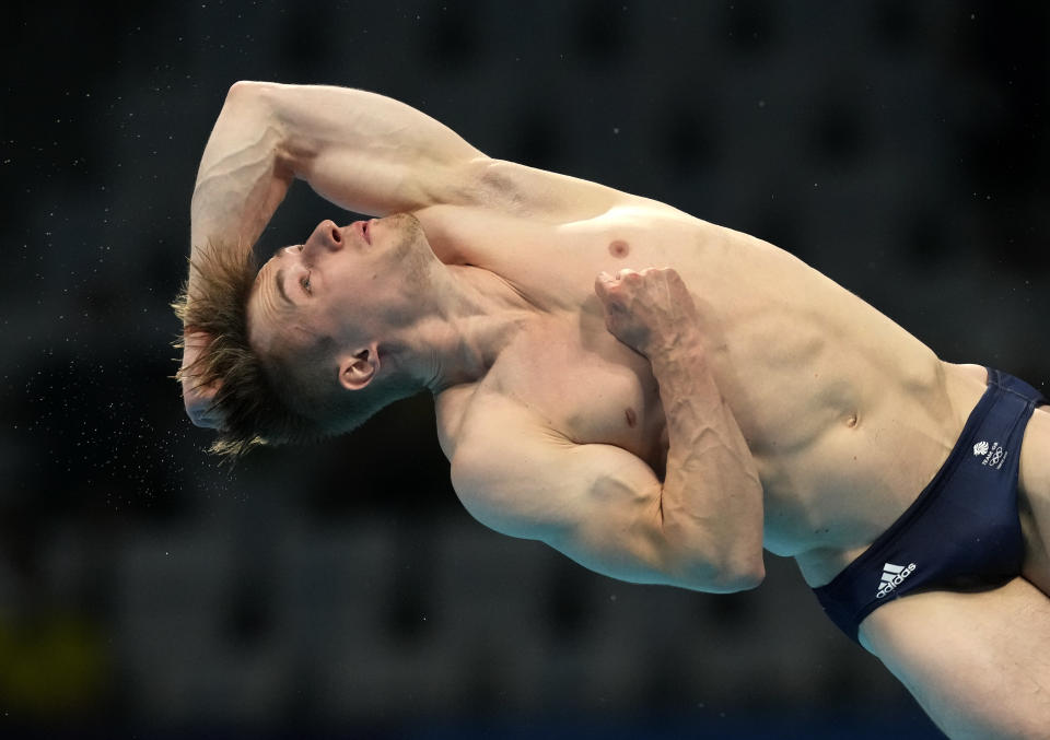 Jack Laugher of Britain competes in men's diving 3m springboard final at the Tokyo Aquatics Centre at the 2020 Summer Olympics, Tuesday, Aug. 3, 2021, in Tokyo, Japan. (AP Photo/Dmitri Lovetsky)
