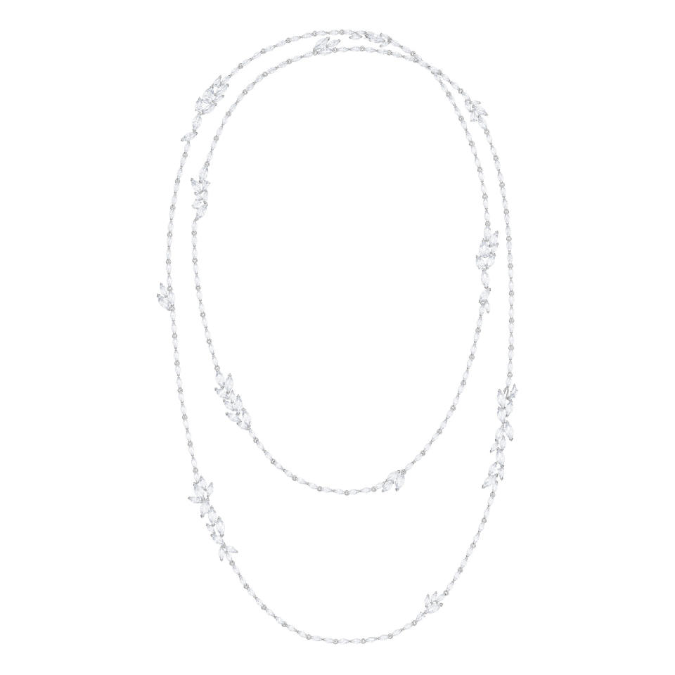 <p><span>Treat yourself or a loved one to a daring and glamorous statement piece with this extraordinary necklace, which can be worn super-long or doubled up for a layered look Inspired by frosty winter leaves and fine jewelry, the Louison Strandage exudes timeless elegance with its rhodium plating and white sparkle, including a special swan wing-shaped cut. </span> </p>