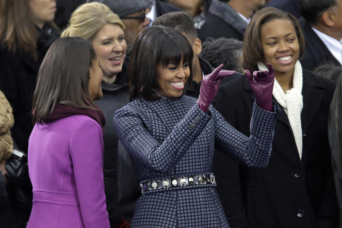 First Lady Michelle waves across the aisle at the ceremonial swearing-in for President Barack Obama at the U.S. Capitol during the 57th Presidential Inauguration in Washington, Monday, Jan. 21, 2013. (AP Photo/Carolyn Kaster)