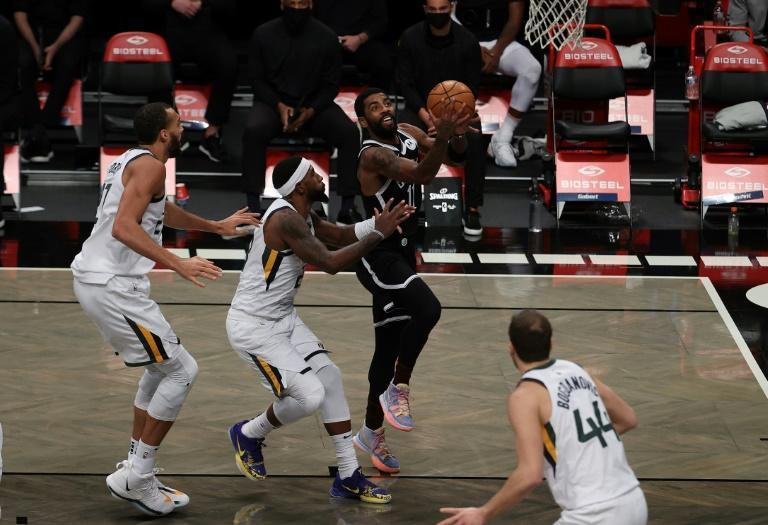 Brooklyn star Kyrie Irving shoots in the Nets' 130-96 NBA victory over the Utah Jazz