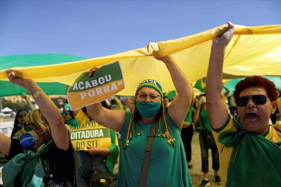 Demonstrators support Jair Bolsonaro in May 2020. The Brazilian president has touted unproven Covid treatments including ivermectin.