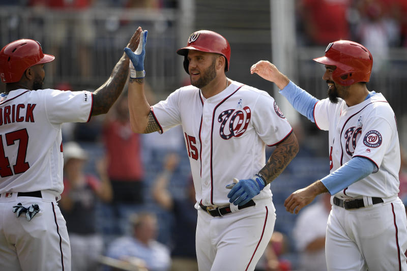 Washington Nationals' Matt Adams, center, celebrate his grand slam with Howie Kendrick, left, and Anthony Rendon, right, during the eighth inning of a baseball game against the Arizona Diamondbacks, Sunday, June 16, 2019, in Washington. (AP Photo/Nick Wass)