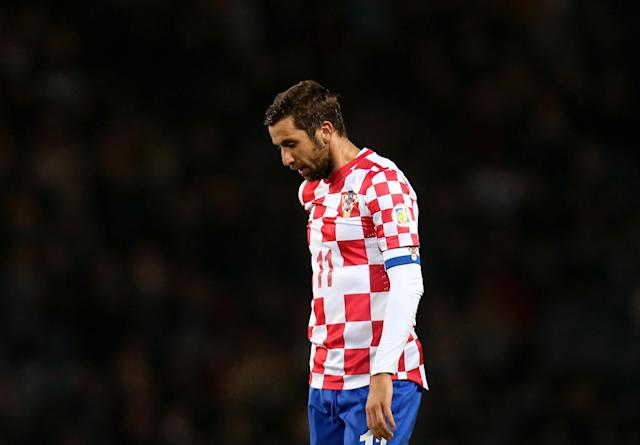 Croatia's captain Darijo Srna stands dejected after being defeated by Scotland at the end of their 2014 World Cup qualifying Group A soccer match at Hampden Park, Glasgow, Scotland, Tuesday Oct. 15, 2013. (AP Photo/Scott Heppell)