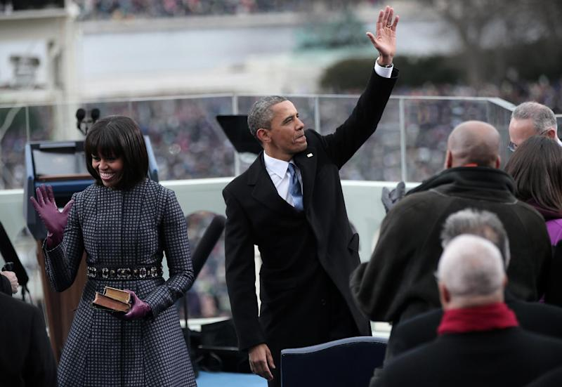 President Barack Obama, accompanied by first lady Michelle Obama, waves after being sworn in by Supreme Court Chief Justice John Roberts on the West Front of the Capitol in Washington, Monday, Jan. 21, 2013, during the 57th Presidential Inauguration.  (AP Photo/Win McNamee, Pool)