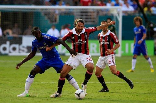 Chelsea's Romelu Lukaku (L) fights for the ball with AC Milan's Mario Yepes during their exhibition match in Miami on July 28. The Blues had more spark Saturday than they did in a 3-2 loss to the Major League Soccer all-star team in the middle of the week